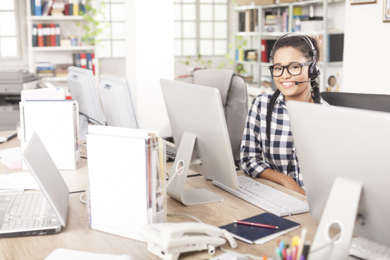 Young female call center operator with headset